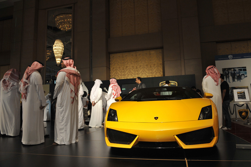. Saudi men inspect a Lamborghini at a luxury auto show in Riyadh, late on October 10, 2011.  FAYEZ NURELDINE/AFP/Getty Images