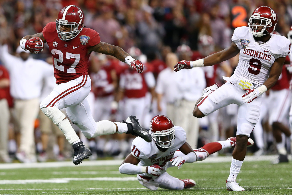 . NEW ORLEANS, LA - JANUARY 02:  Derrick Henry #27 of the Alabama Crimson Tide runs for a 61 yard touchdown against the Oklahoma Sooners during the Allstate Sugar Bowl at the Mercedes-Benz Superdome on January 2, 2014 in New Orleans, Louisiana.  (Photo by Streeter Lecka/Getty Images)