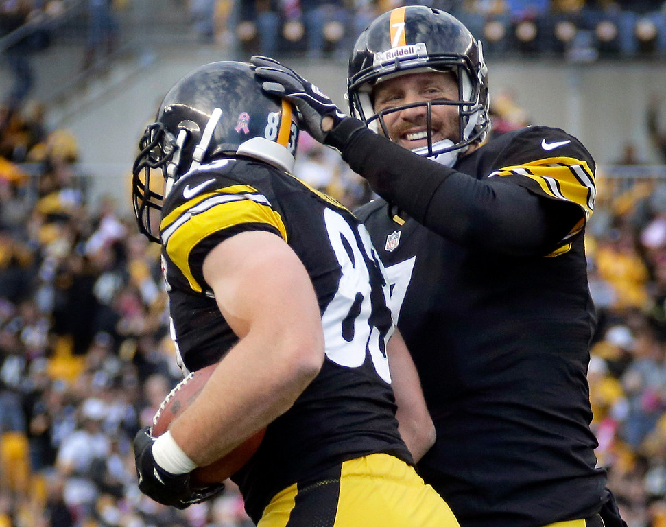 . Pittsburgh Steelers quarterback Ben Roethlisberger, right, greets tight end Heath Miller after Miller caught Roethlisberger\'s pass for a touchdown in the first quarter of an NFL football game against the Baltimore Ravens in Pittsburgh on Sunday, Oct 20, 2013. (AP Photo/Gene J. Puskar)