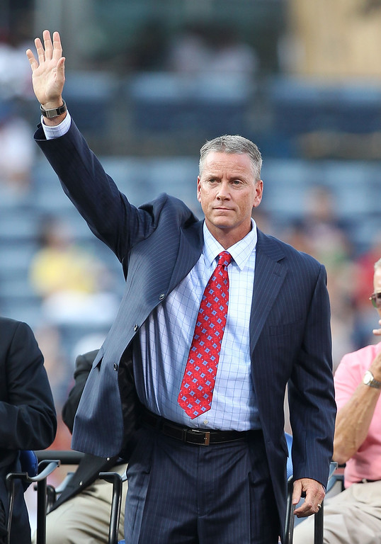 . Former Atlanta Braves pitcher Tom Glavine acknowledges the crowd during the Bobby Cox number retirement ceremony before the game between the Atlanta Braves and the Chicago Cubs at Turner Field on August 12, 2011 in Atlanta, Georgia.  (Photo by Mike Zarrilli/Getty Images)