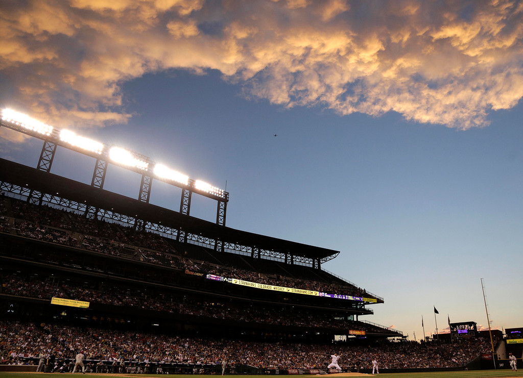. Colorado Rockies pitcher Josh Outman delivers against the Philadelphia Phillies in the sixth inning of a baseball game on Friday, June 14, 2013, in Denver.(AP Photo/Joe Mahoney)