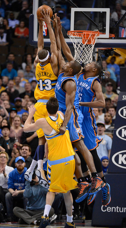 . DENVER, CO. - JANUARY 20: Denver Nuggets small forward Corey Brewer (13) gets fouled byOklahoma City Thunder power forward Serge Ibaka (9) with the help of Oklahoma City Thunder small forward Kevin Durant (35) as he drives to the basket during the fourth quarter January 20,  2013 at Pepsi Center. The Denver Nuggets defeated the Oklahoma City Thunder 121-118 in overtime. (Photo By John Leyba / The Denver Post)