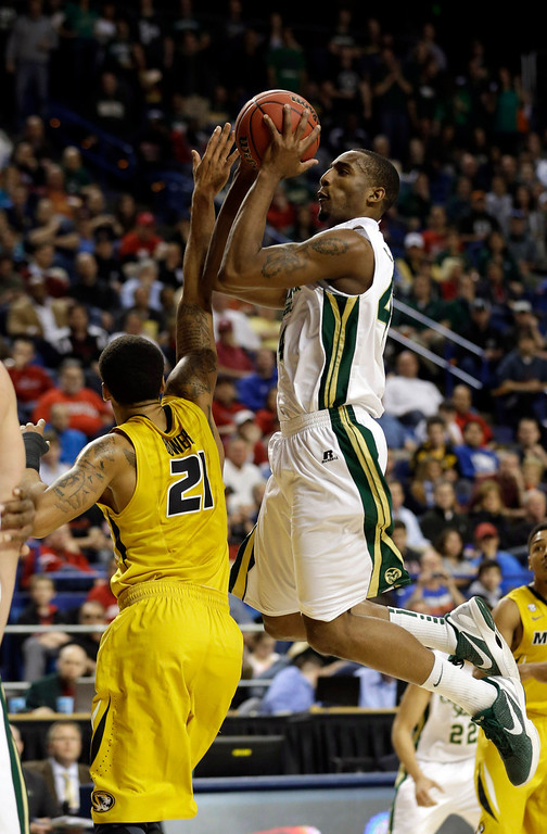 . Colorado State forward Greg Smith, right, shoots as Missouri forward Laurence Bowers (21) defends during the first half  their second-round NCAA college basketball tournament game on Thursday, March 21, 2013, in Lexington, Ky. (AP Photo/John Bazemore)