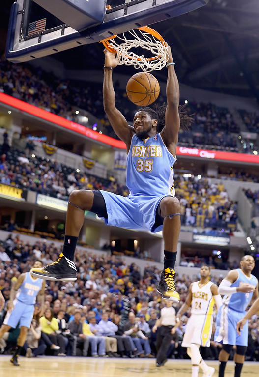 . Kenneth Faried #35 of the Denver Nuggets dunks the ball during the game against the Indiana Pacers at Bankers Life Fieldhouse on February 10, 2014 in Indianapolis, Indiana. (Photo by Andy Lyons/Getty Images)