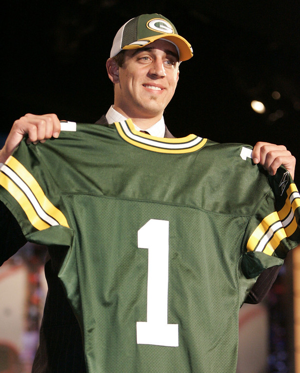. Aaron Rodgers, California Selected 24th overall by the Packers in 2005 Rodgers has done his best to make the 49ers regret not taking him in 2005. In five seasons as the Packers� starting quarterback, Rodgers has been named a Pro Bowler three times, a first-team All Pro once, and was named MVP of Super Bowl XLV. He is 52-26 in 78 career starts with 171 touchdowns and just 46 interceptions. GRADE: A+. Thanks to him, young backup quarterbacks around the league (see: Kevin Kolb, Kellen Clemens, Matt Flynn) will always be held to unrealistic standards when they finally land a starting role. Call it the Aaron Rodgers Rule. (AP Photo/Julie Jacobson)