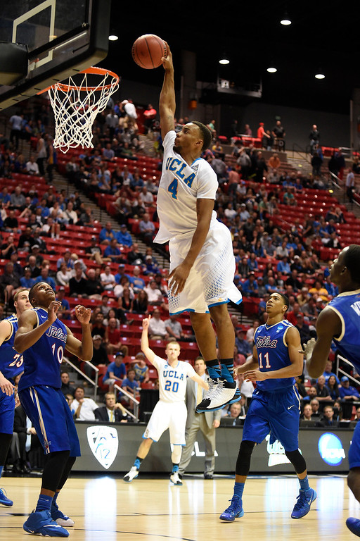 . UCLA guard Norman Powell dunks the basket while playing against Tulsa during the second half of a second-round game in the NCAA college basketball tournament Friday, March 21, 2014, in San Diego. (AP Photo/Denis Poroy)