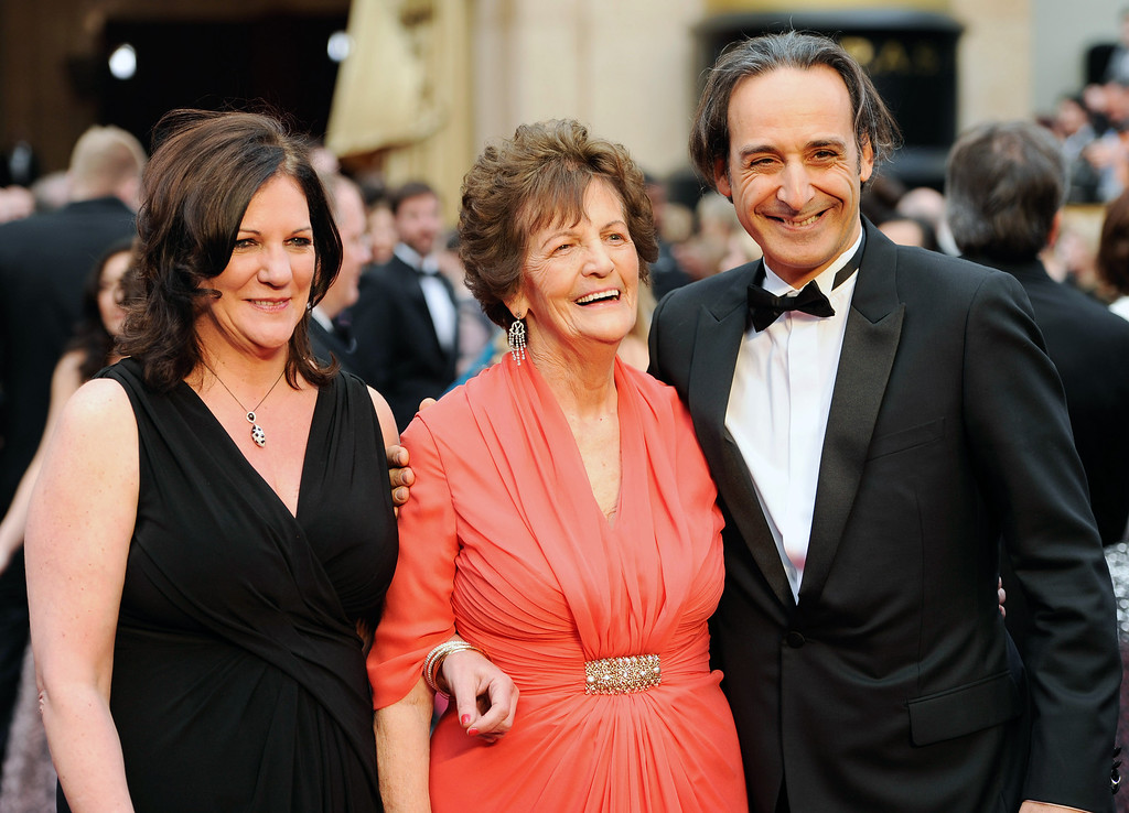 . Jane Libberton, from left, Philomena Lee and Alexandre�Desplat arrive at the Oscars on Sunday, March 2, 2014, at the Dolby Theatre in Los Angeles.  (Photo by Chris Pizzello/Invision/AP)