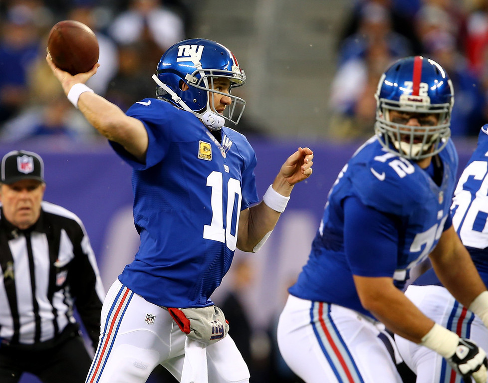 . Eli Manning #10 of the New York Giants passes the ball in the second quarter against the Oakland Raiders at MetLife Stadium on November 10, 2013 in East Rutherford, New Jersey.  (Photo by Elsa/Getty Images)