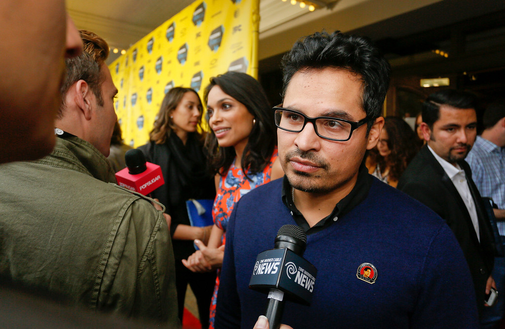 ". Michael Pena arrives at the North American premiere of his film ""Cesar Chavez\"" during the SXSW Film Festival on Monday, March 10, 2014, in Austin, Texas. (Photo by Jack Plunkett/Invision/AP)"