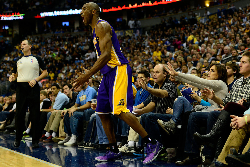 . Los Angeles Lakers shooting guard Kobe Bryant (24) is furious for not getting a foul call during the second half of the Nuggets\' 126-114 win at the Pepsi Center on Wednesday, December 26, 2012. AAron Ontiveroz, The Denver Post