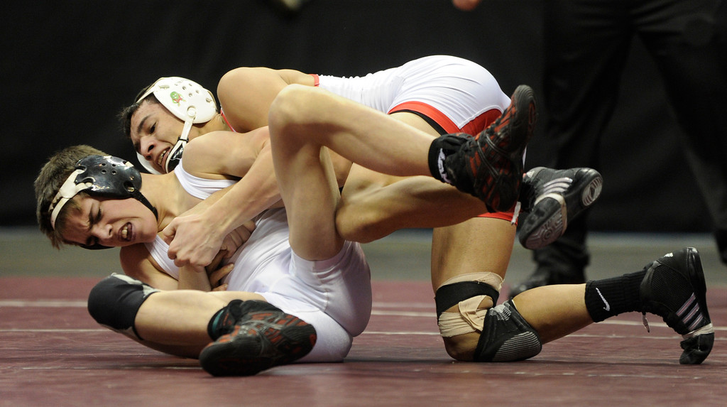 . DENVER, CO. - FEBRUARY 23: Rocky Ford High School junior Adam Baca, right, tangled with Paonia\'s Bo Pipher, left, in the class 2A, 126-pound championship match Saturday night. The CHSAA State Wrestling Tournament wrapped up, February 23, 2013, with final matches following the Parade of Champions at the Pepsi Center in downtown Denver. (Photo By Karl Gehring/The Denver Post)
