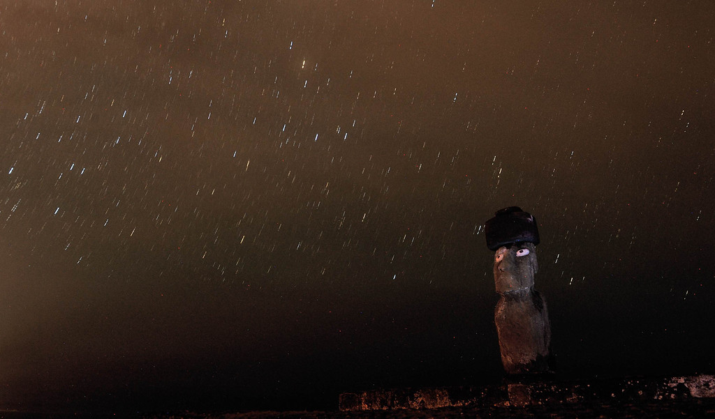 . Night picture of a Moais --stone statue of the Rapa Nui culture-- on Easter Island, 3,700 km off the Chilean coast in the Pacific Ocean, on July 10, 2010.   MARTIN BERNETTI/AFP/Getty Images