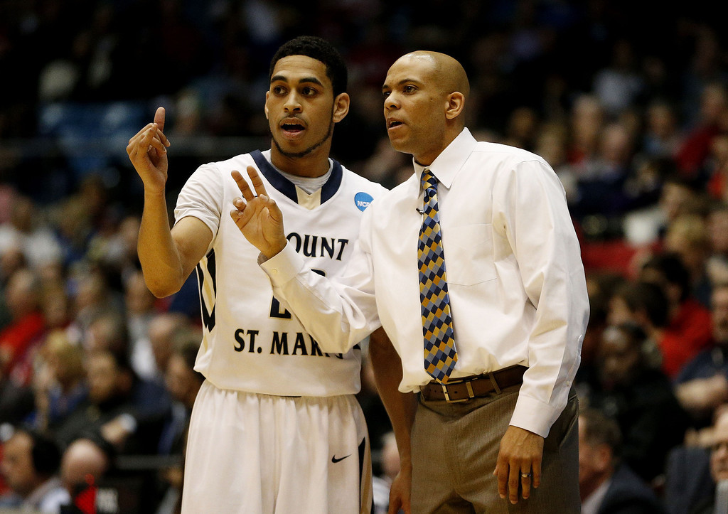 . Head coach Jamion Christian talks to Julian Norfleet #23 of the Mount St. Mary\'s Mountaineers in the first half against the Albany Great Danes during the first round of the 2014 NCAA Men\'s Basketball Tournament at at University of Dayton Arena on March 18, 2014 in Dayton, Ohio.  (Photo by Gregory Shamus/Getty Images)