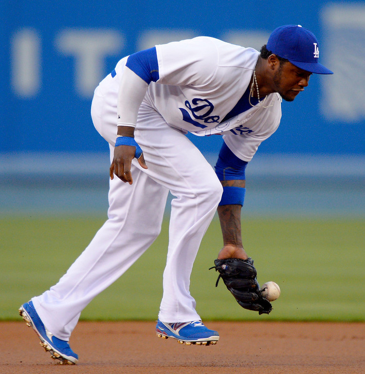 . Los Angeles Dodgers shortstop Hanley Ramirez cannot handle a ball hit for a single by Colorado Rockies\' Eric Young Jr. during the first inning of their baseball game, Wednesday, May 1, 2013, in Los Angeles. (AP Photo/Mark J. Terrill)