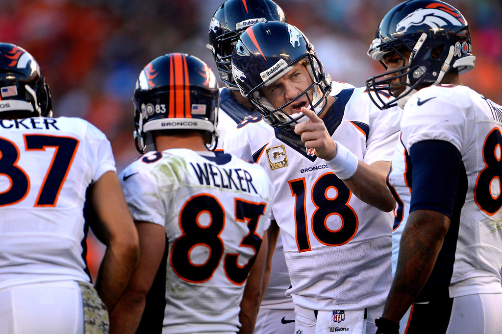 . Broncos quarterback Peyton Manning #18 of the Denver Broncos talks to his receivers in the huddle during the third quarter against the San Diego Chargers at Qualcomm Stadium November 10, 2013.(Photo By Joe Amon/The Denver Post)