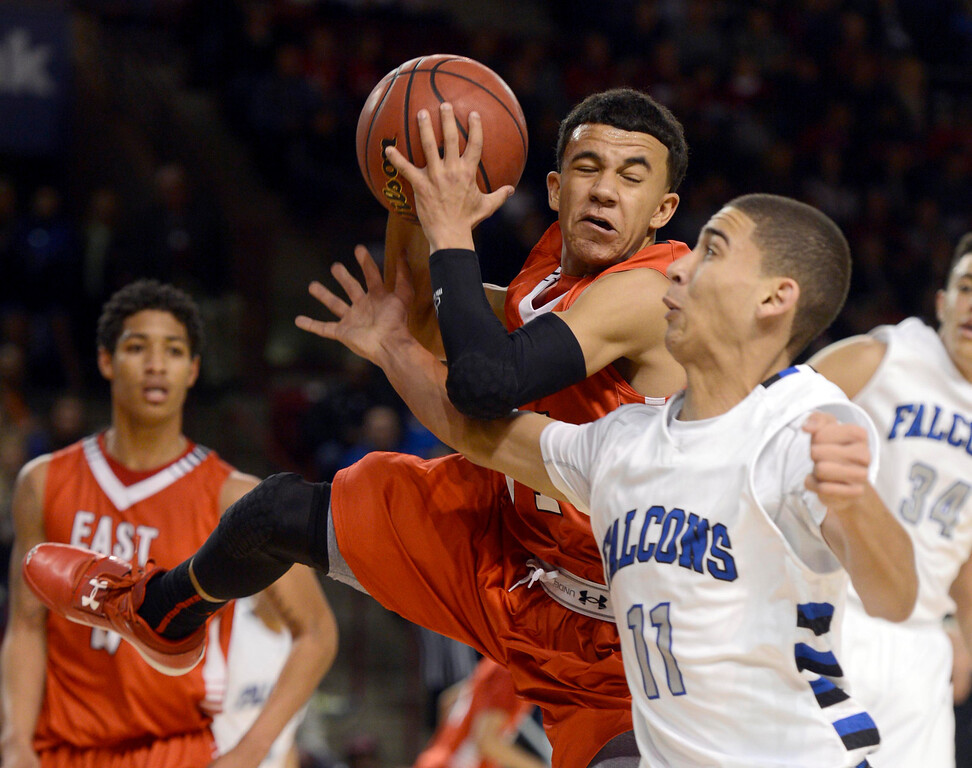 . DENVER, CO. - FEBRUARY 09: Brian Carey (11) of East hauls down a rebound from Isaiah Parros (11) of Highlands Ranch February 9, 2012 at Magness Arena.  East defeated Highlands Ranch 73 - 54. (Photo By John Leyba/The Denver Post)