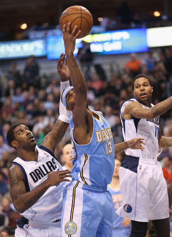 . DALLAS, TX - DECEMBER 28:  Corey Brewer #13 of the Denver Nuggets grabs a rebound against O.J. Mayo #32 of the Dallas Mavericks at American Airlines Center on December 28, 2012 in Dallas, Texas.  NOTE TO USER: User expressly acknowledges and agrees that, by downloading and or using this photograph, User is consenting to the terms and conditions of the Getty Images License Agreement.  (Photo by Ronald Martinez/Getty Images)