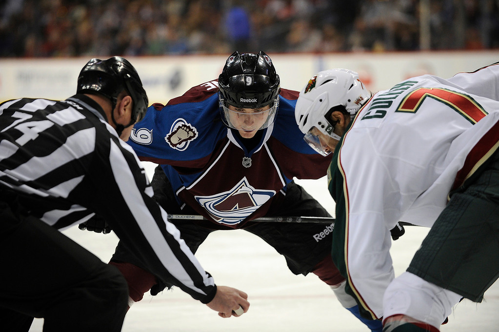 . Matt Duchene (9) of the Colorado Avalanche takes the face off against Matt Cullen (7) of the Minnesota Wild during the third period, Saturday, April 27, 2012 at Pepsi Center. Seth A. McConnell, The Denver Post