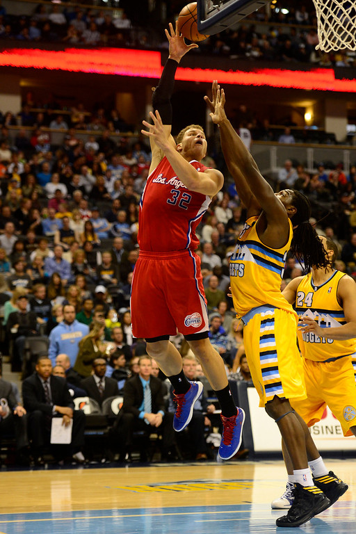 . Denver Nuggets small forward Kenneth Faried (35) forces Los Angeles Clippers power forward Blake Griffin (32) to take a bad shot during the second half of the Nugget\'s 92-78 win at the Pepsi Center on Tuesday, January 1, 2013. AAron Ontiveroz, The Denver Post