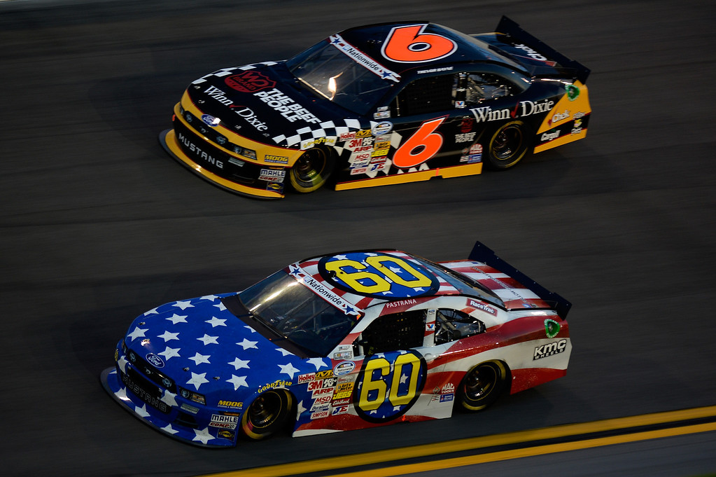 . DAYTONA BEACH, FL - JULY 05:  Travis Pastrana, driver of the #60 Roush Fenway Racing / RaceTrac Ford, races Trevor Bayne, driver of the #6 Cargill / Winn-Dixie Ford Ford, during the NASCAR Nationwide Series Subway Firecracker 250 at Daytona International Speedway on July 5, 2013 in Daytona Beach, Florida.  (Photo by John Harrelson/Getty Images)