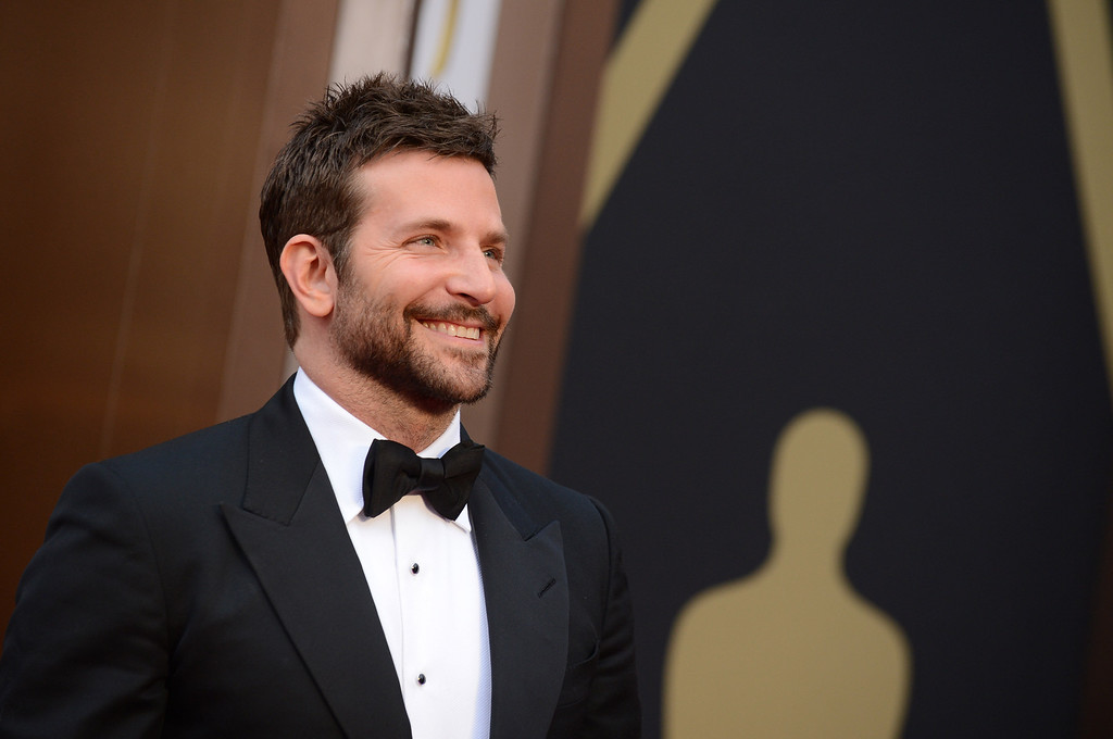 . Bradley Cooper arrives at the Oscars on Sunday, March 2, 2014, at the Dolby Theatre in Los Angeles.  (Photo by Jordan Strauss/Invision/AP)