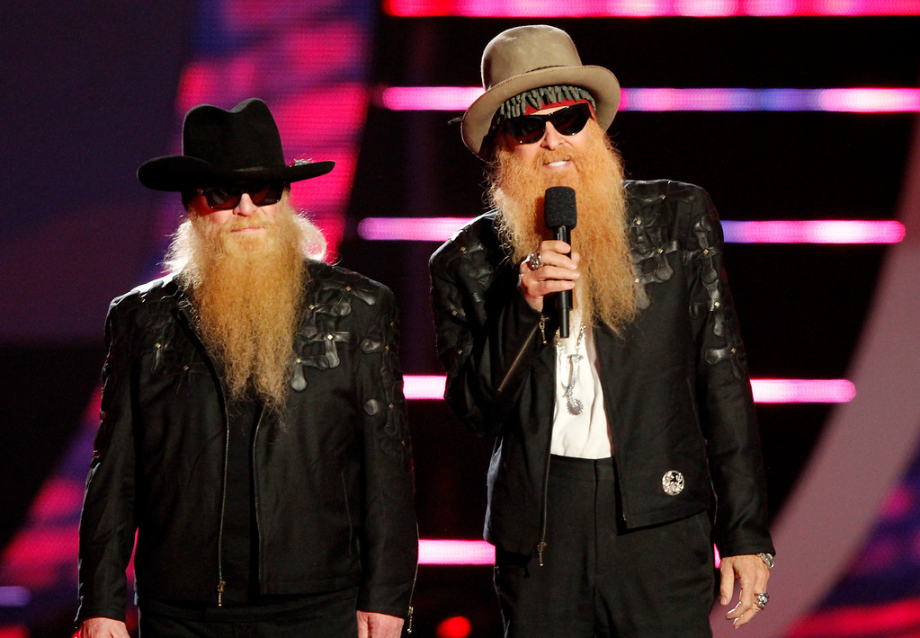 . Dusty Hill, left, and Billy Gibbons of the musical group ZZ Top speak on stage at the CMT Music Awards at Bridgestone Arena on Wednesday, June 4, 2014, in Nashville, Tenn. (Photo by Wade Payne/Invision/AP)