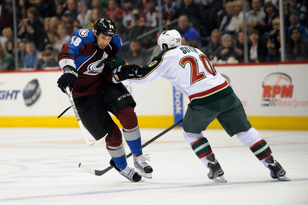 . Patrick Bordeleau (58) of the Colorado Avalanche is forced off the puck by Ryan Suter (20) of the Minnesota Wild as he attempts to carry the puck into the zone during the third period, Saturday, April 27, 2012 at Pepsi Center. Seth A. McConnell, The Denver Post