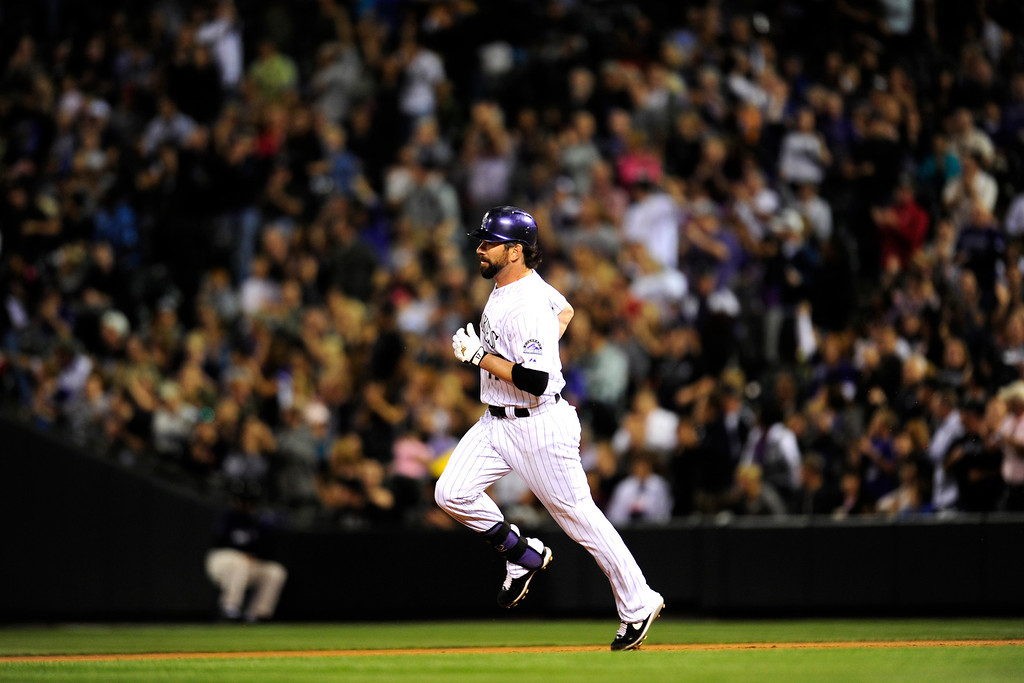 . DENVER, CO. - SEPT 20, 2013:   Todd Helton heads for second base after connecting with the ball.   (Photo By Erin Hull/The Denver Post)