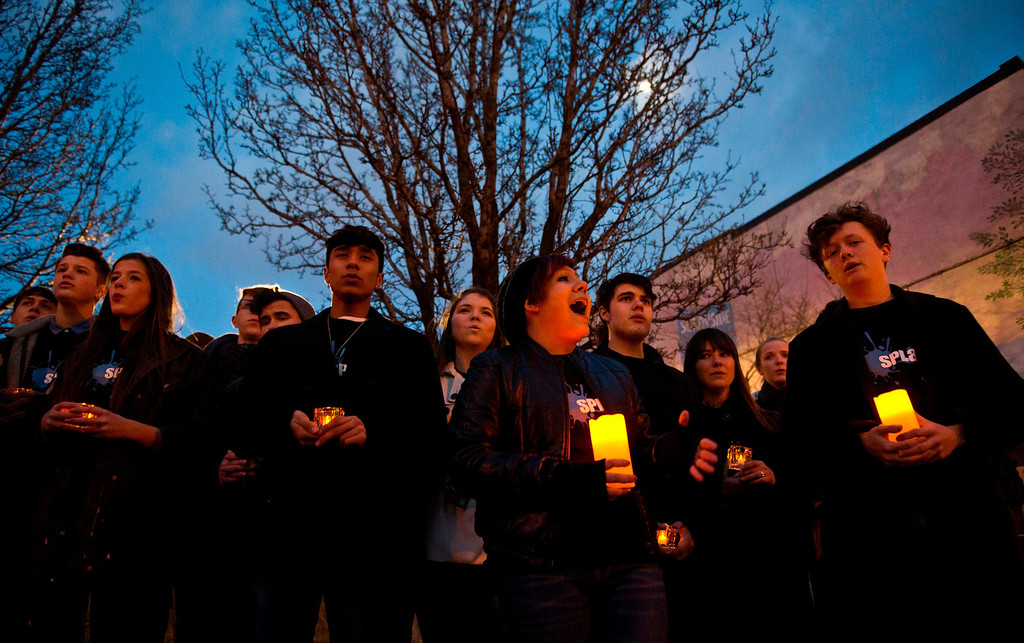 . Members of SPLASH, the Etobicoke School of the Arts\' show choir sing before a WWF-Canada lantern walk in Roncesvalles Village Toronto, celebrating Earth Hour, Saturday, March 23, 2013. (AP Photo/The Canadian Press, Galit Rodan)