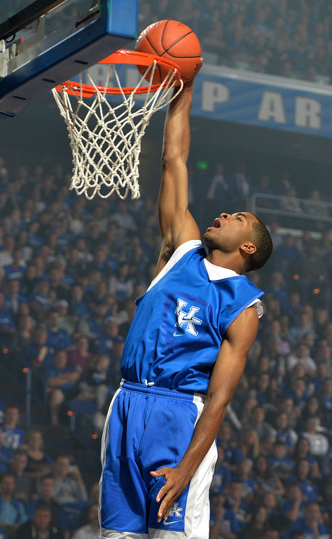 . Kentucky\'s Aaron Harrison goes up for a dunk during the NCAA college basketball team\'s Big Blue Madness, Friday, Oct. 18, 2013, in Lexington, Ky.(AP Photo/Timothy D. Easley)