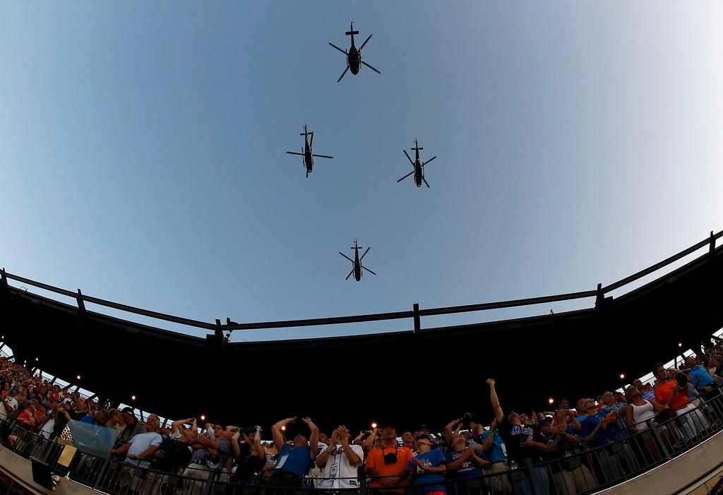 . A flyover of helicopters takes place during the opening ceremonies for Major League Baseball\'s All-Star Game in New York, July 16, 2013.  REUTERS/Shannon Stapleton
