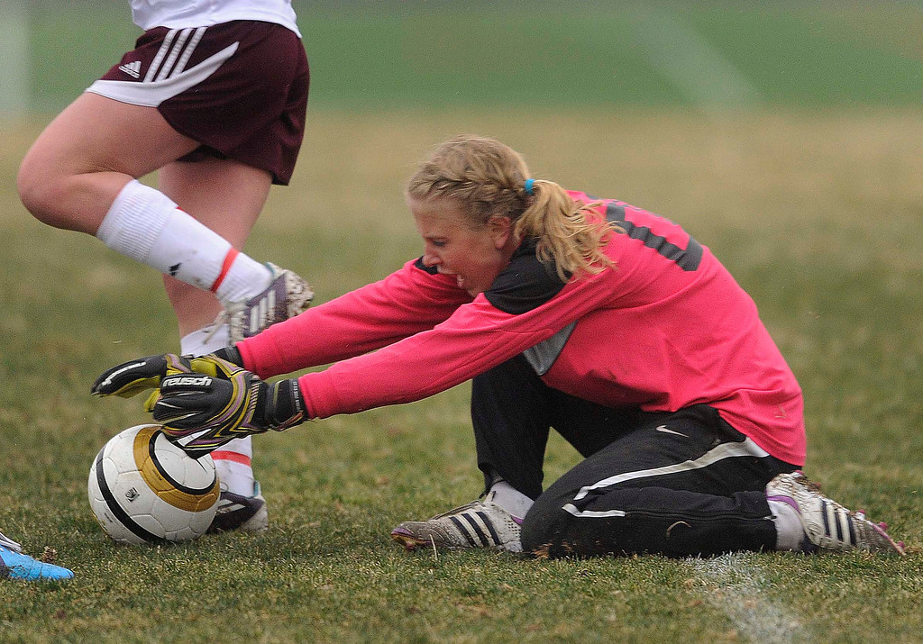 . Mustangs goalkeeper Abigail Eustace (00) made a save in the second half. The Mountain Vista High School girl\'s soccer team defeated Ponderosa 6-0 Tuesday night, April 2, 2013.  Photo By Karl Gehring/The Denver Post)