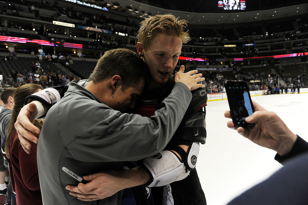 . Gabriel Landeskog (92) of the Colorado Avalanche gives Patrick Hill of Castle Rock a hug after handing Hill his game worn jersey during the Sweaters Off Our Backs promotion following the third period on Saturday, April 27, 2012 at Pepsi Center. Seth A. McConnell, The Denver Post