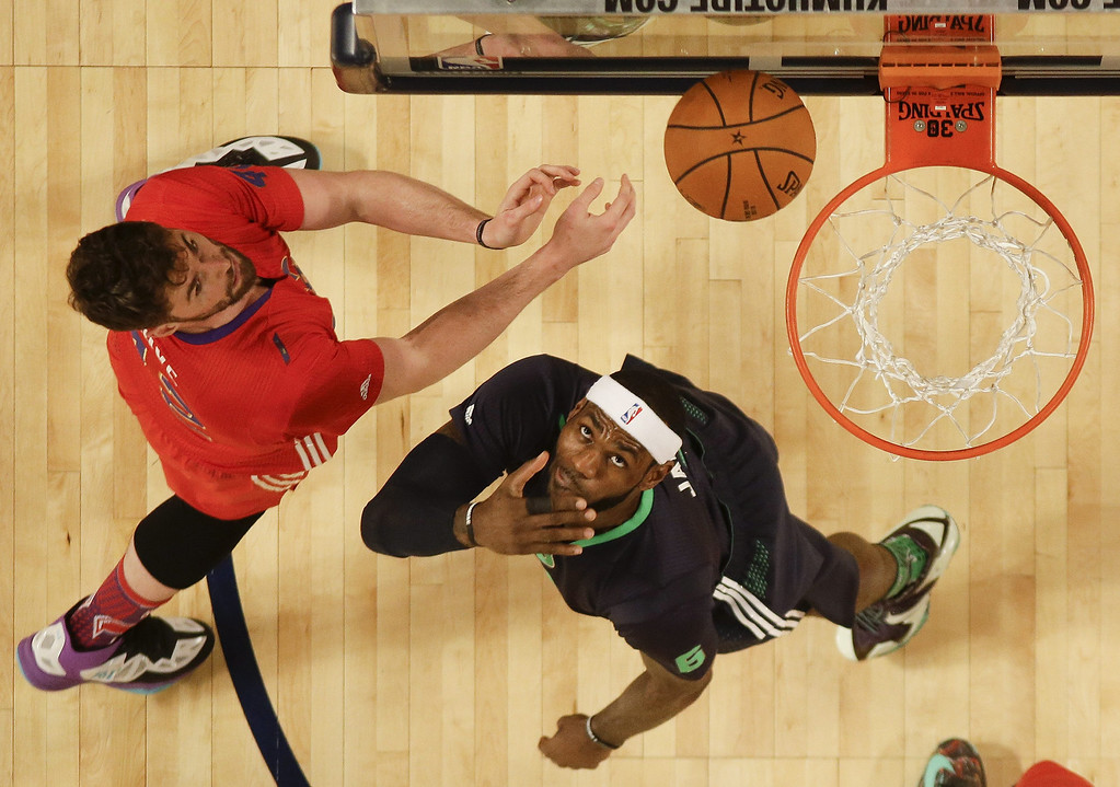 . Eastern Conference forward LeBron James (R) goes to the basket against Western Conference forward Kevin Love (L) in the first half during the 63rd NBA All-Star Game in New Orleans, Louisiana.  EPA/GERALD HERBERT / POOL
