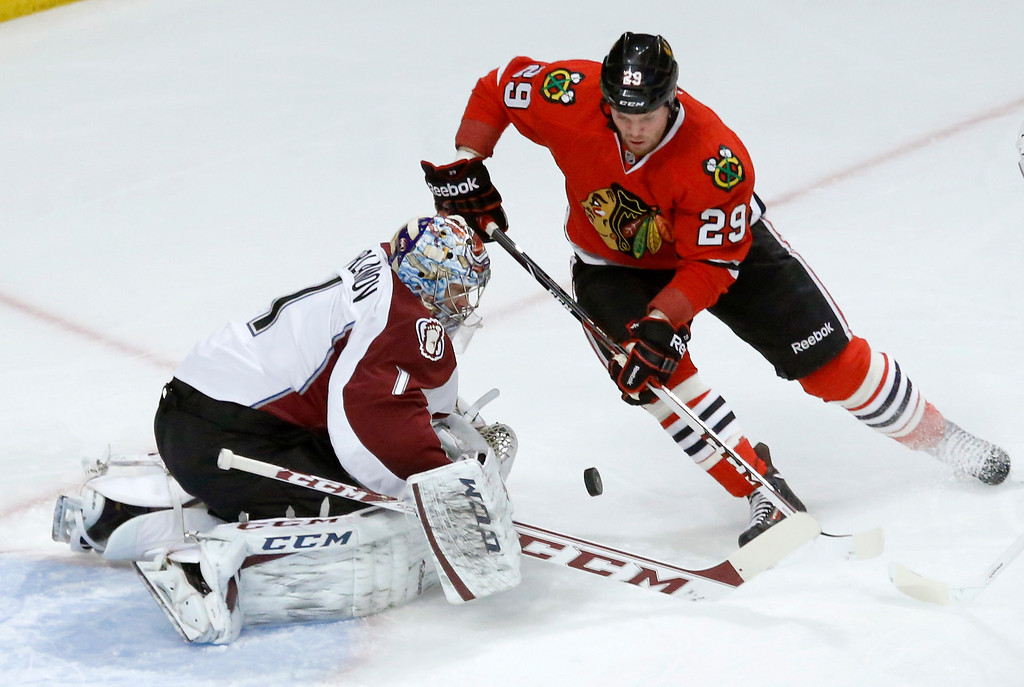 . Colorado Avalanche goalie Semyon Varlamov (1) makes a save on a shot by Chicago Blackhawks left wing Bryan Bickell (29) during the first period of an NHL hockey game Tuesday, Jan. 14, 2014, in Chicago. (AP Photo/Charles Rex Arbogast)