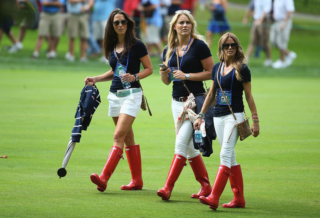 . DUBLIN, OH - OCTOBER 03:  (L-R) Sybi Kuchar, Skiier Lindsey Vonn and Nadine Moze follow the play of the U.S. Team during the Day One Four-Ball Matches at the Muirfield Village Golf Club on October 3, 2013 in Dublin, Ohio.  (Photo by Andy Lyons/Getty Images)