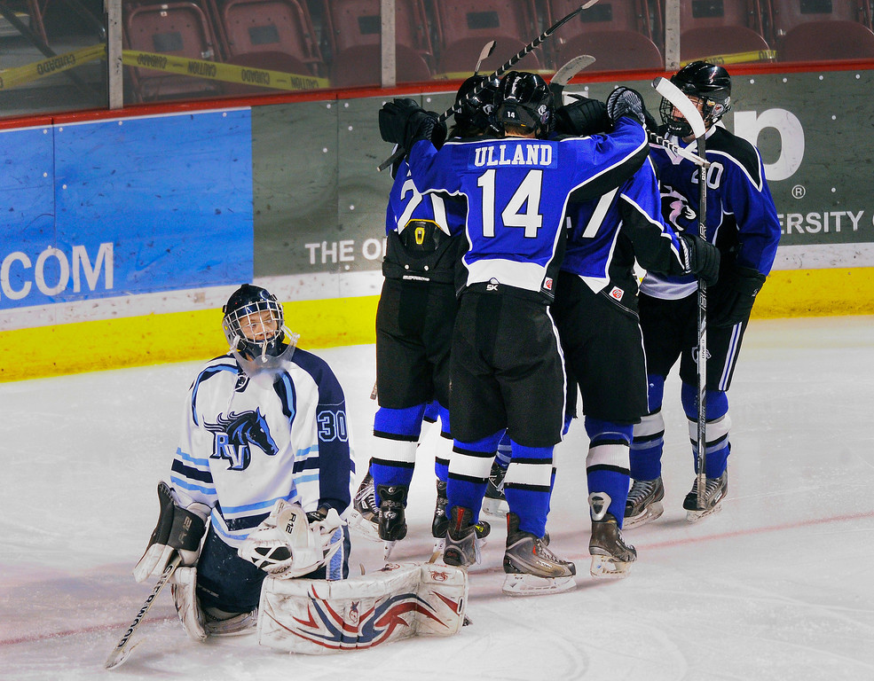 . DENVER, CO. - FEBRUARY 28: The Cougars congratulated defenseman Russell Pavsek (2) after his power play goal he snuck past Mustangs goalie Tyler Anderson (30) in the second period. Ralston Valley High School took on Resurrection Christian Thursday night, February 28, 2013 in a semifinal match in the Colorado State Ice Hockey Championships at Magness Arena in Denver. (Photo By Karl Gehring/The Denver Post)