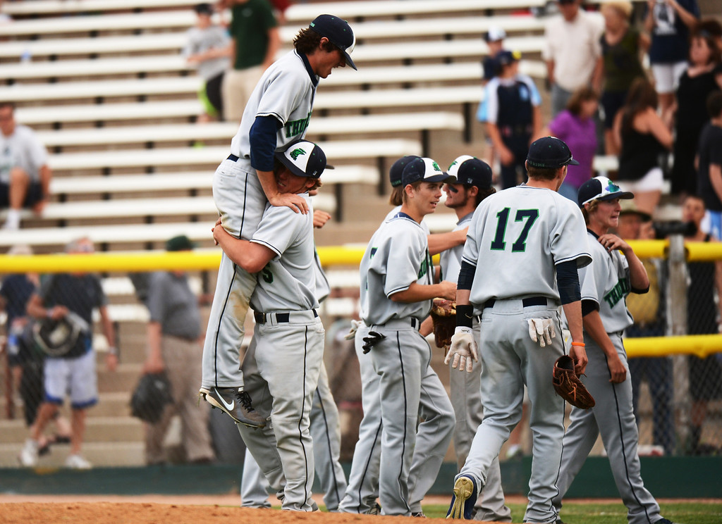 . DENVER, CO. - MAY 24 :ThunderRidge High School players celebrate winning of semifinal round of 5A State Championships baseball game against Cherry Creek High School at All City Field. Denver, Colorado. May 24, 2013. ThunderRidge won 5-1. (Photo By Hyoung Chang/The Denver Post)