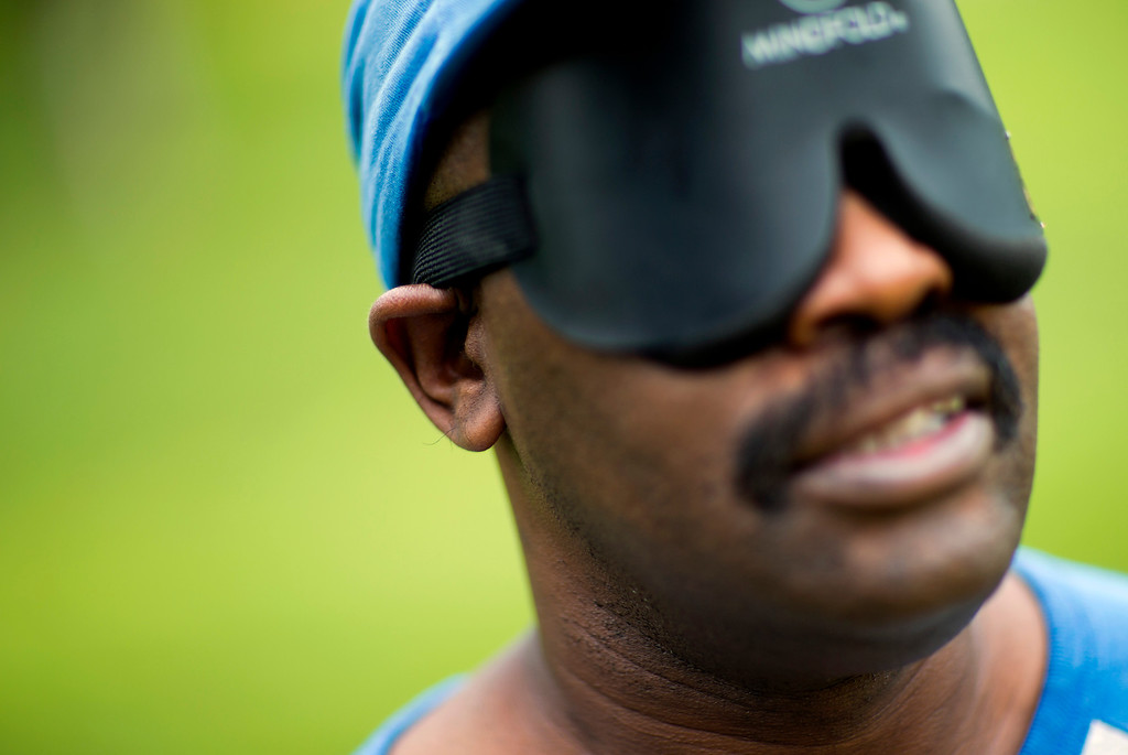 . Jimmie Burnette, who lost his vision to a brain tumor in 2010, listens for the beep of the ball during a blind baseball practice in Atlanta on July 13, 2013. Faced with their own personal challenges in their daily lives, hitting and catching a ball and running full speed in total darkness teaches them they can achieve what was once thought unachievable. (AP Photo/David Goldman)
