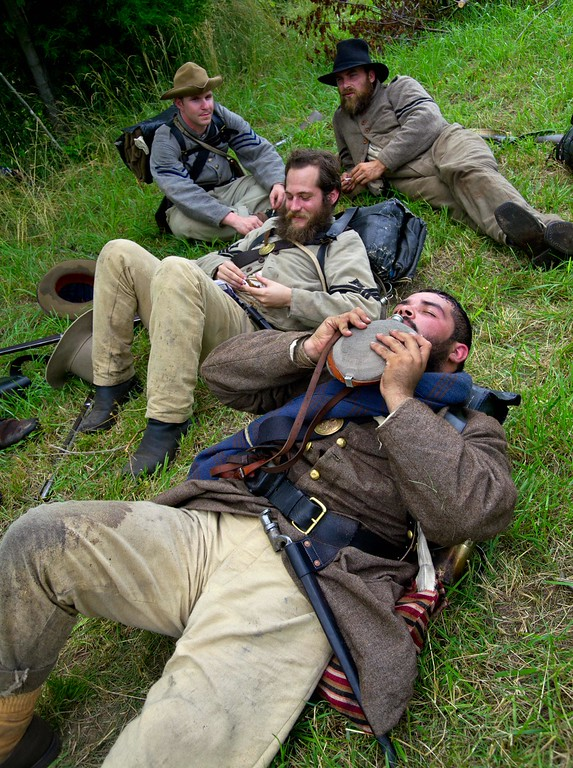 . Confederate soldiers take a break during a re-enactment of the Battle of Gettysburg on June 28, 2013 at the start of the 150th Gettysburg celebration and re-enactments in Gettysburg, Pennsylvania. Over three days, more than 10,000 re-enactors will pay tribute the major battles that took place in Gettysburg during the 1861-1865 US Civil War. KAREN BLEIER/AFP/Getty Images