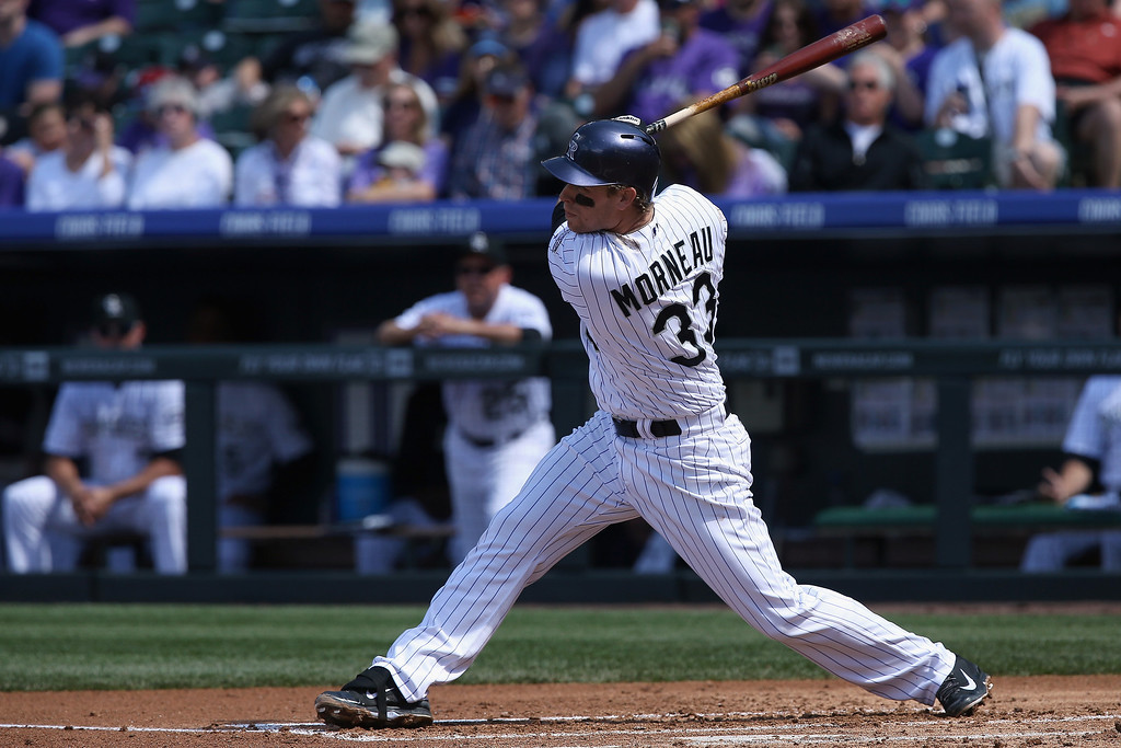 . Justin Morneau #33 of the Colorado Rockies hits an RBI single to score Brandon Barnes #1 of the Colorado Rockies and tie the score 1-1 with the Philadelphia Phillies in the first inning at Coors Field on April 20, 2014 in Denver, Colorado.  (Photo by Doug Pensinger/Getty Images)