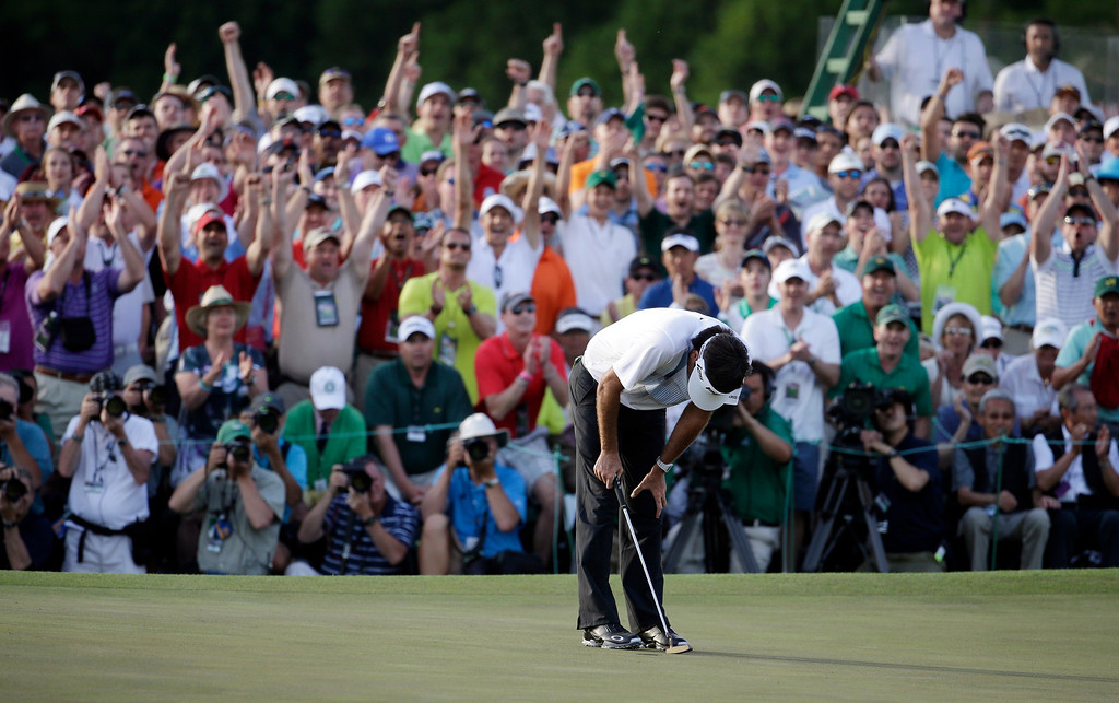 . Bubba Watson reacts after winning the Masters golf tournament Sunday, April 13, 2014, in Augusta, Ga. (AP Photo/Darron Cummings)