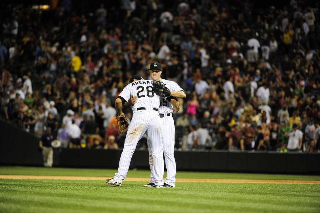 . DENVER - JUNE 28: Jodan Pacheco #15 of the Colorado Rockies hugs teammate Nolan Arenado #28 after defeating the San Francisco Giants 4-1 on June 28, 2013 at Coors Field. (Photo By Grant Hindsley / The Denver Post)