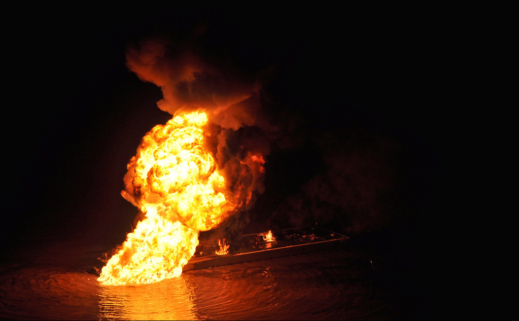 . This image provided by the U.S. Coast Guard shows a pipeline burning after a collision near Bayou Perot 30 miles south of New Orleans, Tuesday March 12, 2012.  (AP Photo/US Coast Guard, Petty Officer 3rd Class Carlos Vega)