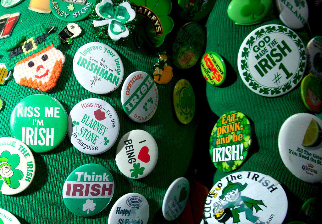 . Buttons are seen on Dennis Dunn\'s sweater as he watches the St. Patrick\'s Day Parade in New York, March 16, 2013.  REUTERS/Carlo Allegri