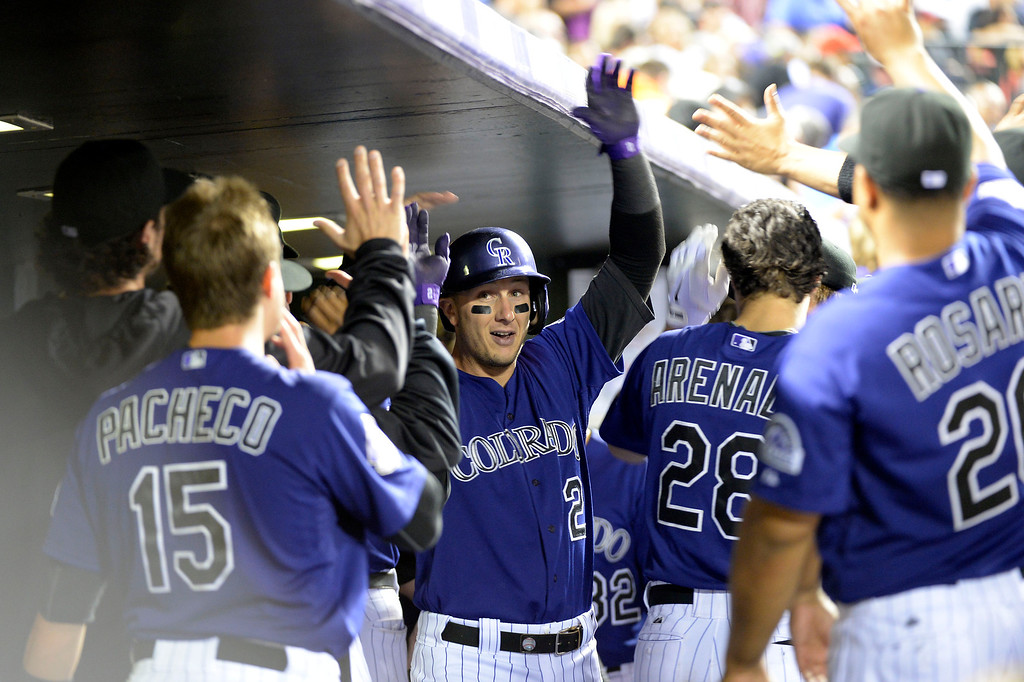 . DENVER, CO. - SEPTEMBER 24: Troy Tulowitzki (2) of the Colorado Rockies is congratulated in the dugout after hitting a home run in the third inning agains the Boston Red Sox September 24, 2013 at Coors Field. (Photo by John Leyba/The Denver Post)