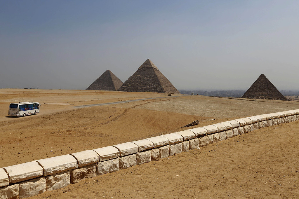 . A general view of the historical site of the Giza Pyramids, near Cairo, Egypt, Tuesday, Aug. 27, 2013. The chairman of the Egyptian Airports Co. says some flights are arriving nearly empty to Egypt and that passenger traffic in the past week has fallen by half. Due to the country\'s violent turmoil, some flights that can carry more than 100 passengers from Europe arrive with just nine and return full from beach resorts. (AP Photo/Lefteris Pitarakis)