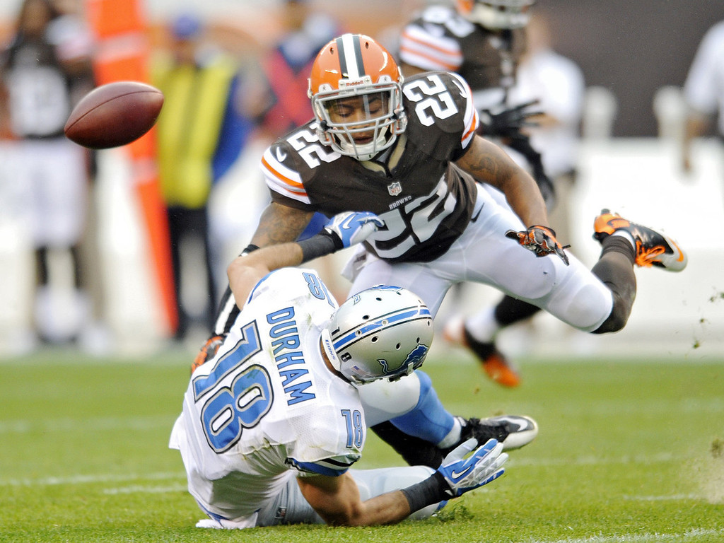 . Cleveland Browns cornerback Buster Skrine (22) breaks up a pass intended for Detroit Lions wide receiver Kris Durham (18) in the first quarter of an NFL football game Sunday, Oct. 13, 2013 in Cleveland. (AP Photo/David Richard)