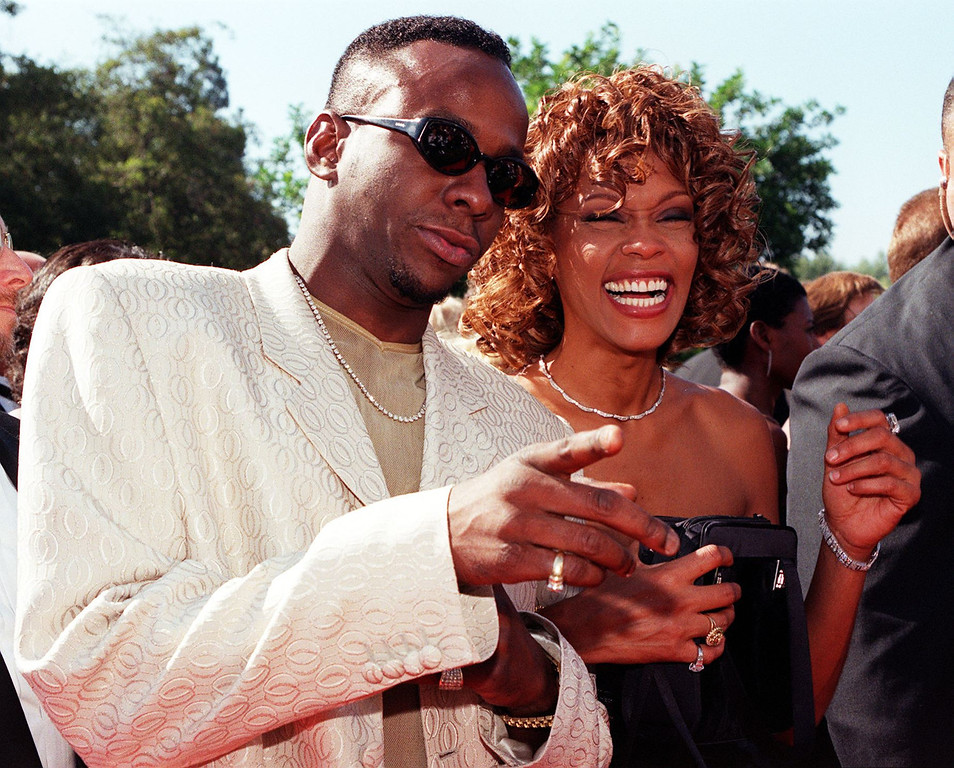 . Singer Whitney Houston (R) and her husband singer Bobby Brown (L) arrive at the 50th Annual Primetime Emmy Awards 13 September at the Shrine Auditorium in Los Angeles, CA.   LUCY NICHOLSON/AFP/Getty Images