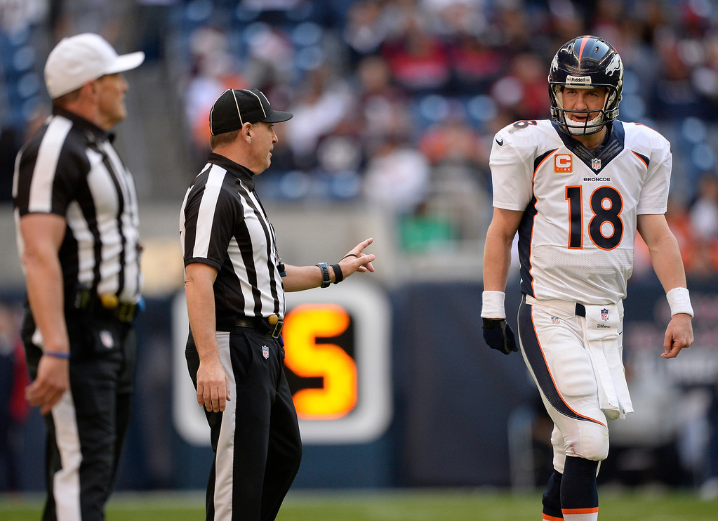 . Denver Broncos quarterback Peyton Manning (18) talks to the referees about a penalty on the Houston Texans during the fourth quarter December 22, 2013 at Reliant Stadium. (Photo by John Leyba/The Denver Post)